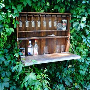 Wall-mounted outdoor drinks storage solution don't come any more stylish than this clever outdoor Murphy bar. Made from a recycled pallet, the fold-down door is held up by strong chains for security and doubles as a prep table. There's even interior storage for your drinks glasses too.And if you want to build your own outdoor bar, here are 10 inspiring ideas.