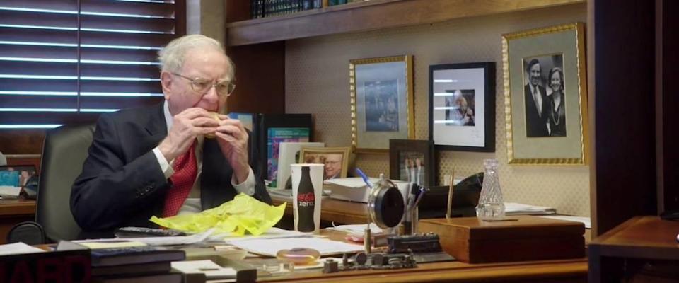 Warren Buffett eating a burger